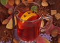 Cup of mulled wine closeup and various spices on table Royalty Free Stock Photography