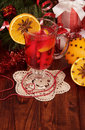 Cup of mulled wine on lacy napkin surrounded by christmas decorations Stock Photography