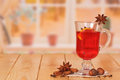 Cup of mulled wine with spices on the kitchen table Stock Photos