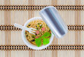 Cup noodles open the lid on floor is made of bamboo Royalty Free Stock Photos