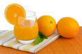 Cup of orange juice and fresh Royalty Free Stock Images