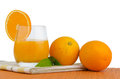 Cup of orange juice and fresh Royalty Free Stock Photography