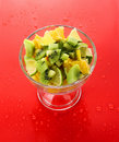 Cup with orange, kiwi and lime Stock Photo