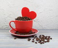 Cup red with coffee grains, heart Royalty Free Stock Photo