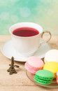 Cup of red tea and colored cakes Royalty Free Stock Photo