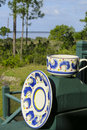 Cup and saucer a coffee on a front porch rail in the morning sun overlooking st andrews east bay in panama city fl Stock Photos