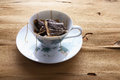 Cup and Saucer with Teabags Royalty Free Stock Photo