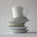 Cup On Several Saucers Stock Image