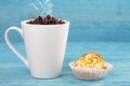 Cup of steaming coffee and cake on a background blue boards Royalty Free Stock Photo