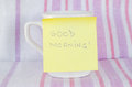 Cup with sticky note good morning handwritten Stock Photos