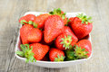 Cup of strawberries fresh and natural on wooden table Stock Photo