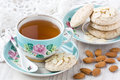 Cup tea with almond cookies Royalty Free Stock Photo