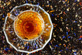 Cup of tea on background of dry tea with fruit and flower petals Royalty Free Stock Photo