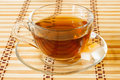 Cup of tea on bamboo tablecloth a in a transparent Royalty Free Stock Photos