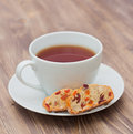 Cup of tea with biscotti cranderries apricots and almond italian pastries Stock Images