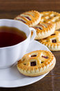 Cup of tea and biscuits with jam close up Royalty Free Stock Photos