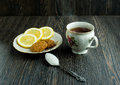 Cup of tea with biscuits and lemon on top, hot tea with lemon and sugar Royalty Free Stock Photo