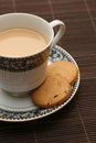 A cup of tea with biscuits served Stock Photography