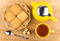 Cup of tea, biscuits and sugar cubes on wooden table Royalty Free Stock Photo