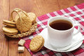 Cup of tea with biscuits on a wooden table Stock Photos
