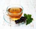Cup of tea and black currant Royalty Free Stock Photo