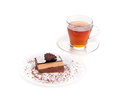Cup of tea with cake on a white background closeup Stock Image