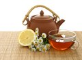 Cup of tea, chamomile and clay teapot Stock Images
