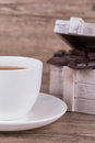 Cup of tea and chocolate on wooden background Royalty Free Stock Image