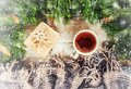 Cup of tea on christmas background. Christmas morning. Selective focus Royalty Free Stock Photo