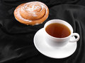 Cup of tea or coffee with sweet cake on black material background Royalty Free Stock Image