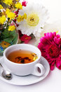 Cup of tea with flower on table Stock Images