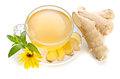 Cup of tea with ginger slices and Echinacea flower Royalty Free Stock Photo