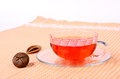Cup of tea in a glass a glass saucer and decoration Royalty Free Stock Image