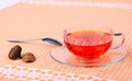 Cup of tea in a glass a glass saucer a spoon and decoration Stock Images