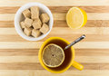 Cup of tea with lemon and bowl of lumpy sugar Royalty Free Stock Photo