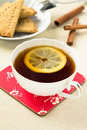 Cup tea lemon cookies served light tablecloth Royalty Free Stock Images