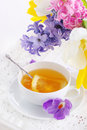 Cup of tea with lemon and flowers Royalty Free Stock Photography
