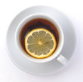 Cup of tea with a lemon on white background Stock Image