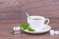 Cup tea mint wooden background Stock Images