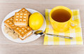 Cup of tea on napkin, biscuits, lemon and lumpy sugar Royalty Free Stock Photo