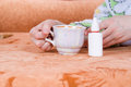 Cup of tea and a nasal spray Royalty Free Stock Photo
