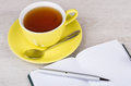Cup of tea, open notebook and ballpoint pen Royalty Free Stock Photo