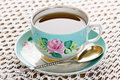 Cup of tea porcelain with silver gold spoon and saucer Stock Photos