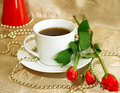 Cup of tea and red roses Royalty Free Stock Image
