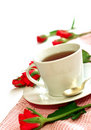 Cup of tea and red roses on white Royalty Free Stock Photos