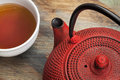 Cup of tea with red tetsubin a a detail a traditional cast iron japenese teapot Stock Image