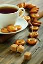 Cup of tea and small bagels with poppy seeds. Royalty Free Stock Image