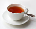 Cup of tea with a spoon on white table Stock Image