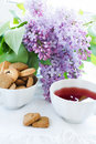 Cup of tea and spring flowers Royalty Free Stock Photography