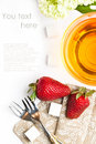 Cup of tea and strawberries over white Stock Images